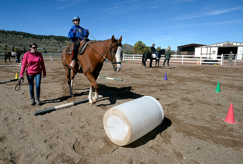 Koda Sterling, 14, a Turner Middle School eighth-grader, rides a horse named Mac Tuesday, Oct. 10, 2017, through an obstacle course he set up at Hearts & Horses Theraputic Riding Center in Loveland. Students from five middle schools are spending Tuesdays at the ranch for eight weeks in the Changing Leads program, learning social and emotional skills while working with the horses. (Photo by Jenny Sparks/Loveland Reporter-Herald)