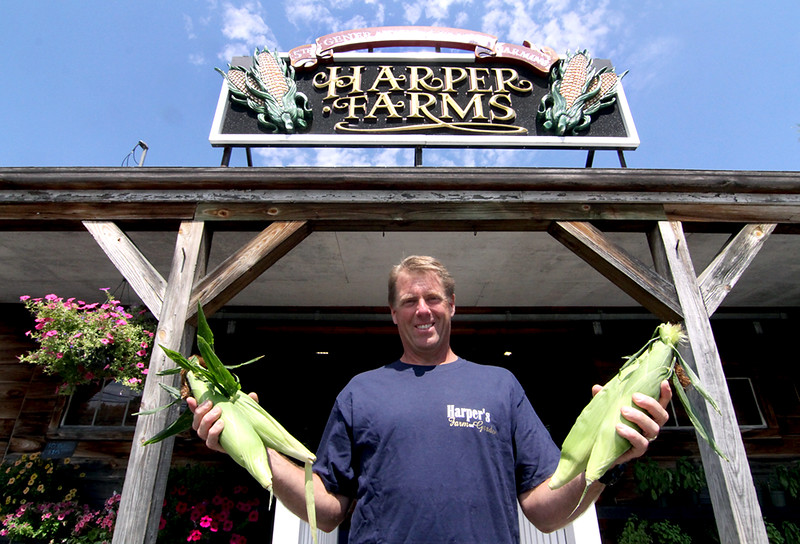 Dave Harper owner of Harper Farms, shown here in front of his stand in Lancaster with fresh picked corn. SEN/David H. Brow