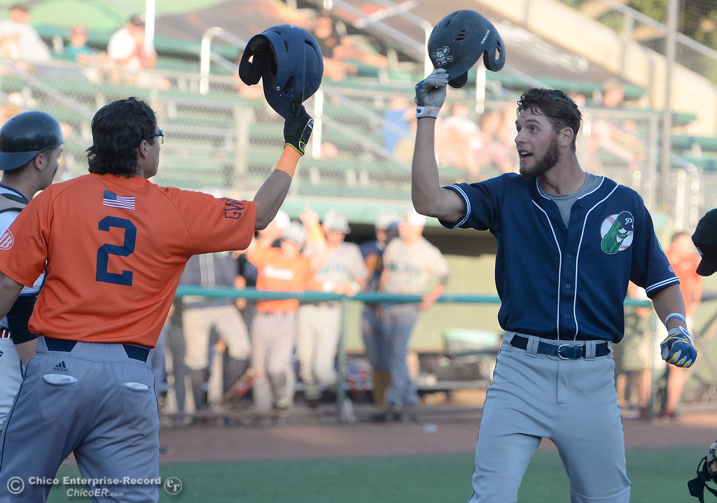 . At right, #24 Zander Clarke of the Portland Pickles gets a helmet tap from #2 Isaiah Garcia of the Lincoln Potters after driving him home with a two run homer in the second inning during the Chico Heat vs All Stars baseball game at Nettleton Field in Chico, Calif. Mon. July 24, 2017.  (Bill Husa -- Enterprise-Record)