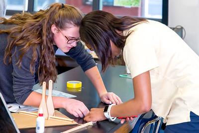 Allie Carter and Mariah Hagood working on their physics trebuchet.