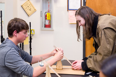 9th graders Blake Carter and Ellie Bliese assemble their trebuchet.