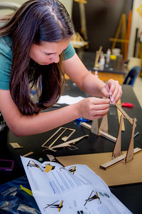 Hanna Jacobson attaches the bindings onto the throwing hook of her trebuchet.