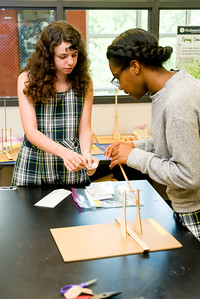 Isabelle Herndon and Chi Chi Nwanagu adjusting the sling of their trebuchet.