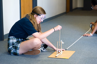 Claire McDonald attaching the sling to the firing hook of her trebuchet.