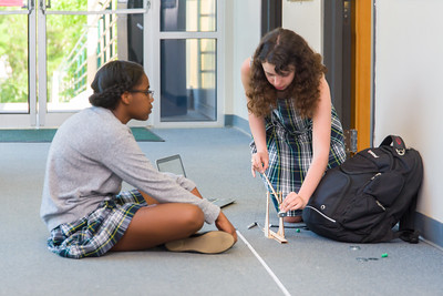 Chi Chi Nwanagu and Isabelle Herndon test firing their trebuchet in the hallway on Friday afternoon.