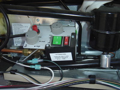 Electricity for the fans came by tapping into the Black (positive) and White - (ground) 12 volt wires that are in the fridge compartment...