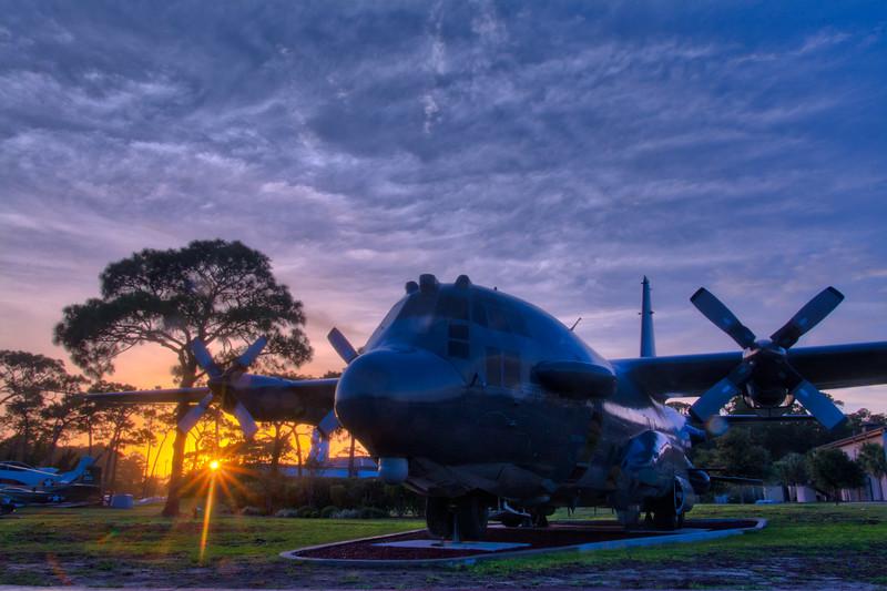 "The sun setting behind the retired AC-130H Spectre Gunship known as ""Wicked Wanda"" at Hurlburt Field in Florida."