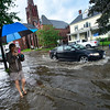 KRISTOPHER RADDER - BRATTLEBORO REFORMER<br /> Penelope Wurr records drivers as they drive through the flooded section of Main Street, in Brattleboro, Vt., after a heavy rain causes flash flooding around the Brattleboro area on Monday, June 19, 2017.
