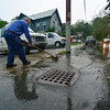 KRISTOPHER RADDER - BRATTLEBORO REFORMER<br /> Don Dompier, owner of Dompier Electric, clears out the drain grates near his business on Elliot Street during one of the strong storms that came through the Brattleboro area on Monday, June 19, 2017.