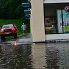 KRISTOPHER RADDER - BRATTLEBORO REFORMER<br /> People drive near the curb of the AT&T Store to avoid walking through the flooded parking lot after a heavy rain causes flash flooding around the Brattleboro area on Monday, June 19, 2017.