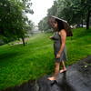 KRISTOPHER RADDER - BRATTLEBORO REFORMER<br /> Dusa Heller walks around Thomas B. Lynch Park during one of the strong storms that came through the Brattleboro area on Monday, June 19, 2017.