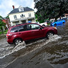 KRISTOPHER RADDER - BRATTLEBORO REFORMER<br /> Cars try to make it through the flooded section of Main Street, in Brattleboro, Vt., after a heavy rain causes flash flooding around the Brattleboro area on Monday, June 19, 2017.