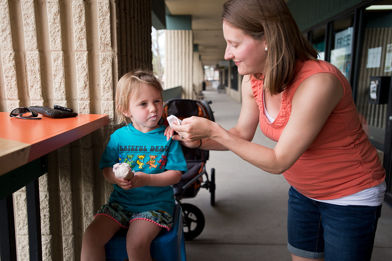 "Luaren Winer helps her daughter Coppen Winer, 3, clean ice cream off her face while eating at Heifer and the Hen in Boulder on Thursday. Brewer Ian Clark branched out into ice cream, opening Heifer and the Hen next door to Bru.  <br /> More photos:  <a href=""http://www.dailycamera.com"">http://www.dailycamera.com</a><br /> Autumn Parry/Staff Photographer<br /> May 5, 2016"
