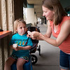 """Luaren Winer helps her daughter Coppen Winer, 3, clean ice cream off her face while eating at Heifer and the Hen in Boulder on Thursday. Brewer Ian Clark branched out into ice cream, opening Heifer and the Hen next door to Bru.  <br /> More photos:  <a href=""""http://www.dailycamera.com"""">http://www.dailycamera.com</a><br /> Autumn Parry/Staff Photographer<br /> May 5, 2016"""
