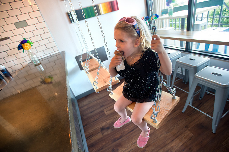 "Lauren Thamer, 3, eats ice cream on the swings at Heifer and the Hen in Boulder on Thursday. Brewer Ian Clark branched out into ice cream, opening Heifer and the Hen next door to Bru.  <br /> More photos:  <a href=""http://www.dailycamera.com"">http://www.dailycamera.com</a><br /> Autumn Parry/Staff Photographer<br /> May 5, 2016"