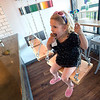 """Lauren Thamer, 3, eats ice cream on the swings at Heifer and the Hen in Boulder on Thursday. Brewer Ian Clark branched out into ice cream, opening Heifer and the Hen next door to Bru.  <br /> More photos:  <a href=""""http://www.dailycamera.com"""">http://www.dailycamera.com</a><br /> Autumn Parry/Staff Photographer<br /> May 5, 2016"""