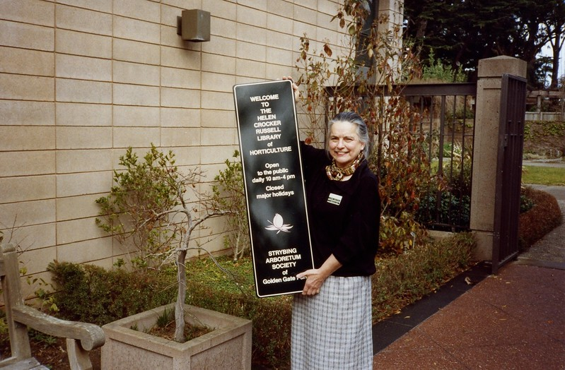 Jane Gates with New Library Sign, 1981