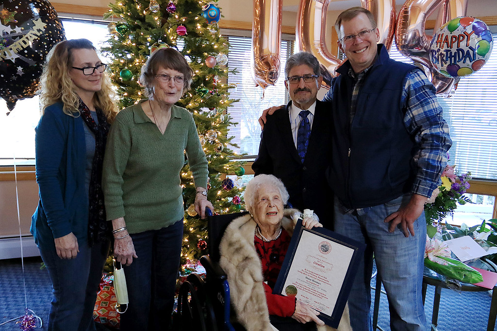 . Helen Hornsey celebrated her 104 birthday on Tuesday, December 4, 2018 at the The Gables on John Fitch Highway in Fitchburg. Fitchburg Mayor Stephen DiNatale, second from right standing, posed with Helen and her only living relatives at the party. From left is Erika Alcorn, Johanna Alcorn, DiNatale and Robert Alcorn. SENTINEL & ENTERPRISE/JOHN LOVE