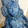 "Here you can see some of the detail in the finished sculpture entitled ""Storyteller.""."