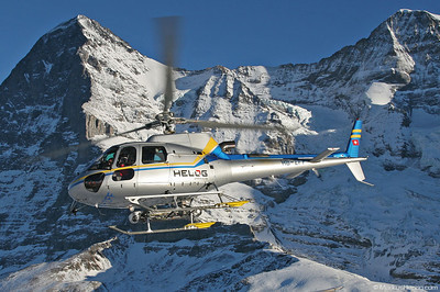 HB-ZFF AS350B3 Helog @ Lauberhorn Switzerland 15Jan05 - In the background Eiger 3970m and Mönch 4107m