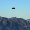 Goodyear Blimp clears the snowy mountains just east of Akron Fulton Airport.