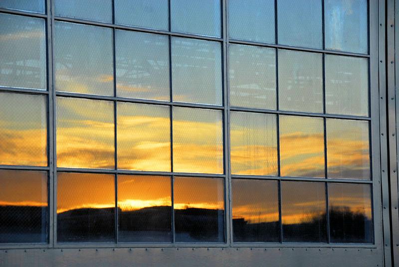 Sunset reflected in hangar windows