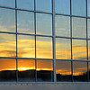 Sunset reflected in hangar windows