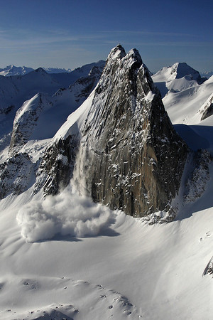 impressive avalanche roaring down the 600m east face of Snowpatch Spire, Bugaboos