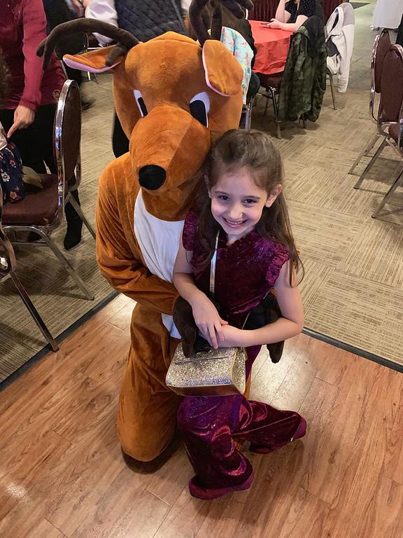 . Evanthia Kazanis of Tewksbury gets to meet Rudolph.