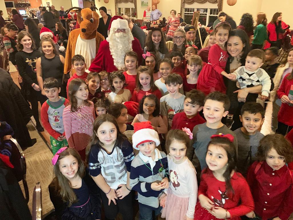 . The HAA kids hang with Santa and Rudolphs.