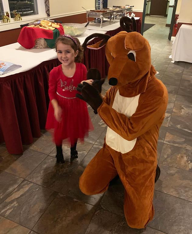 . Fay Kefalas of Billerica gets to meet Rudolph.