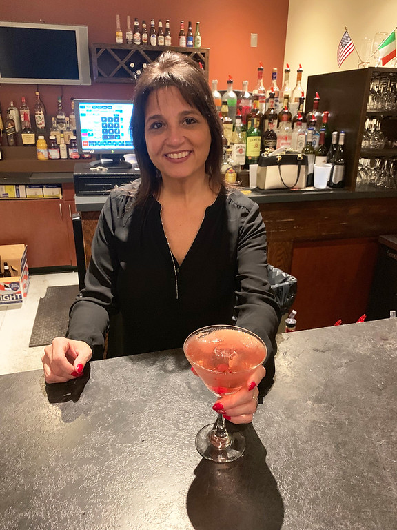 . Glamorous bartender Maria King of Chelmsford mixes up a Rudolph Martini.