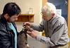 DAVID LACHANCE — BENNINGTON BANNER<br /> Veterinarian George Glanzberg, right, looks over Nova, as the dog's owner, John Realmuto, looks on.