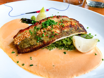 Roasted pike-perch with spinach quinoa, grilled asparagus and lobster sauce
