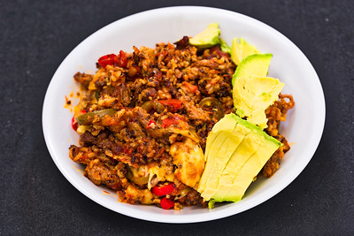 Minced beef with quinoa rice, spicy Bolognese sauce and avocado