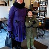 The Finns have a reputation for being shy and reluctant to engage in conversation, especially with strangers. So when this young woman came into the gastropub where Leif & I were having lunch, I hesitated a moment before asking her if I could take a photograph of her in her amazing purple coat. But she agreed with a smile, and told me she had gotten it from the local Goth store. The paint on her boots reveals she's an artist. Even her son got into the moment, striking poses. Finns are shy? Not always ;)