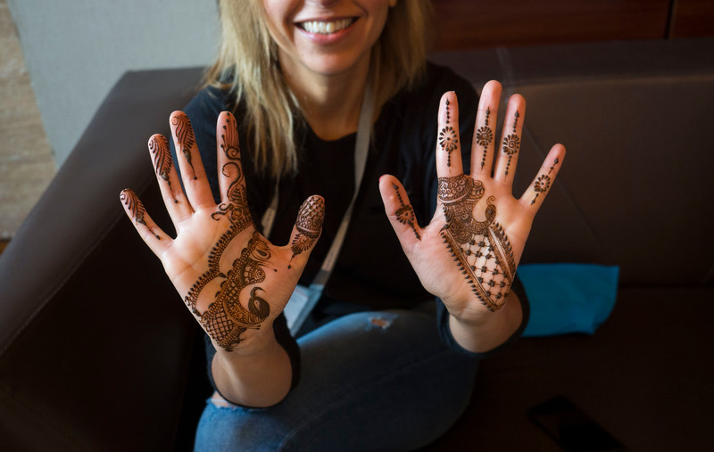Attendees have Henna applied during the break