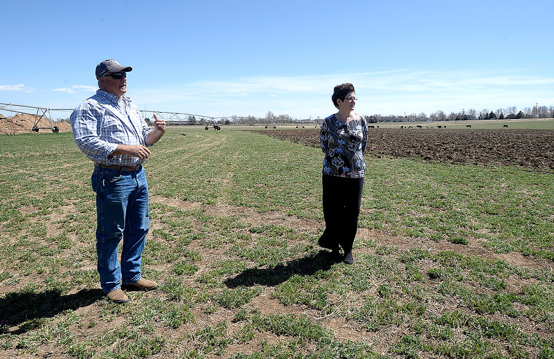 Tom Hewson, left, shows Loveland Mayor Jackie Marsh the field Wednesday, April 11, 2018, where he plans to grow hemp on the northwest corner of First Street and Wilson Avenue in Loveland.    (Photo by Jenny Sparks/Loveland Reporter-Herald)