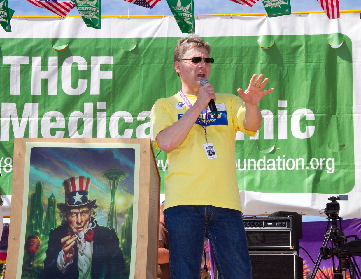Seattle City Attorney Pete Holmes speaks on Main Stage at Seattle Hempfest 2013.   Photo by Janis Marie
