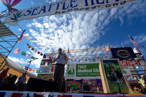 Seattle Mayor Mike McGinn speaks on Main Stage at Seattle Hempfest 2013.  Photo by INNERCHIE