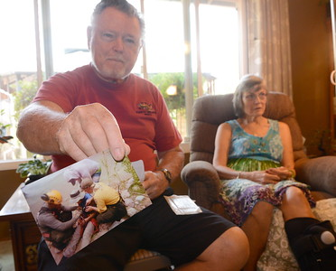 Ed Hemsley holds a photo of Linda about to get loaded into a basket to be airlifted out of remote terrain as he and Linda talk about their unique 50th wedding anniversary during an interview at their Oroville, Calif. home Thursday Aug. 2, 2018.  (Bill Husa -- Enterprise-Record)