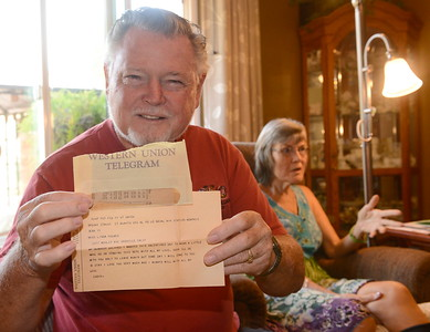 Ed Hemsley shows an original Western Union Telegram he sent Linda for Valentines Day in 1967 as they talk about their unique 50th wedding anniversary during an interview at their Oroville, Calif. home Thursday Aug. 2, 2018.  (Bill Husa -- Enterprise-Record)