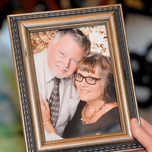 Ed and Linda Hemsley of Oroville hold a photo of themselves as they talk about their unique 50th wedding anniversary during an interview at their Oroville, Calif. home Thursday Aug. 2, 2018.  (Bill Husa -- Enterprise-Record)
