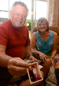 Ed Hemsley holds a photo of he and his wife Linda when he was in the Navy as they talk about their unique 50th wedding anniversary during an interview at their Oroville, Calif. home Thursday Aug. 2, 2018.  (Bill Husa -- Enterprise-Record)