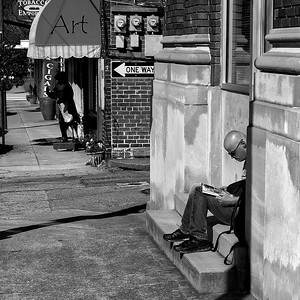Reading on the stoop