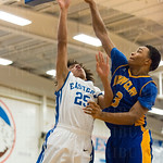 Javen Rushin (25) attempted a layup over Leander Ridgeway (3).