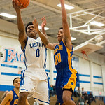 Henry Clay\'s Isaiah Tisdale (00) challenged Eastern\'s Dominique Knight (0) under the basket.