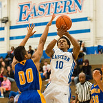 Eagles G Braxton Johnson (10) put up a short jumper just outside the lane.