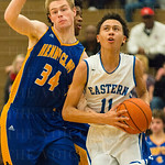 Chance Moore (11) cut past Walt Finch (34) while eyeing the hoop.