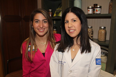 Community Events Coordinator Lindsay Mata (left) and dietitian Halle Saperstein, RD, were on-hand to help out at the Mediterranean cooking demonstration held Wednesday, March 29, 2017, in the hospital's Demonstration Kitchen. Photo by Roy J. Akers / For The Oakland Press